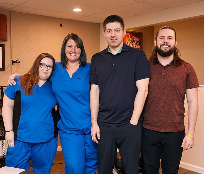 Our Chiropractic team wearing their scrubs and work uniforms