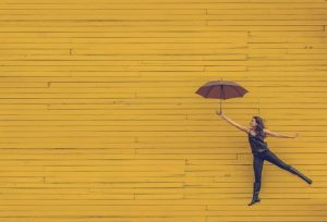 woman with umbrella in a happy experience